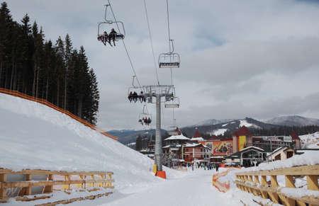 Bukovel, Ukraine - February 23, 2013  Skiers get to the mountain using the chairlift in Bukovel ski resort, Ukraine  on February 23, 2013