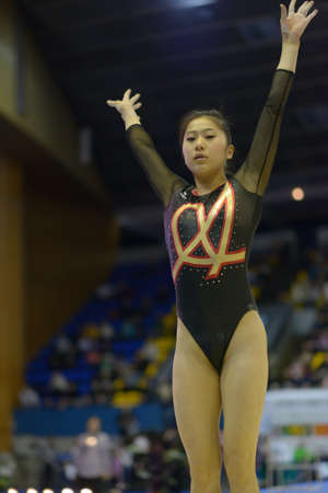 landed: Kiev, Ukraine - March 31, 2013: Noda Sakura, Japan landed after routine on balance beam during International Tournament in Artistic Gymnastics Stella Zakharova Cup in Kiev, Ukraine on March 31, 2013