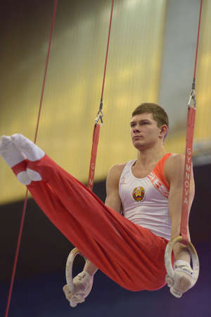 Kiev, Ukraine - March 30, 2013: Vasiliy Mikhalitsyn, Belarus performs exercise on still rings during International Tournament in Artistic Gymnastics Stella Zakharova Cup in Kiev, Ukraine on March 30, 2013