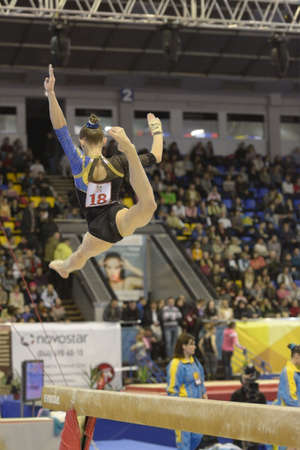 Kiev, Ukraine - March 31, 2013: Elena Vasilyeva, Ukraine performs exercise on balance beam during International Tournament in Artistic Gymnastics Stella Zakharova Cup in Kiev, Ukraine on March 31, 2013