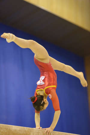 Kiev, Ukraine - March 31, 2013: Noda Sakura, Japan performs exercise on balance beam during International Tournament in Artistic Gymnastics Stella Zakharova Cup in Kiev, Ukraine on March 31, 2013