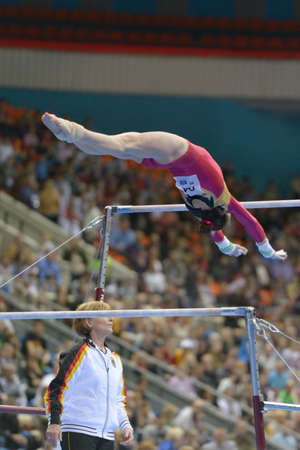 Moscow, Russia - April 20, 2013  Sophie Scheder, Germany performs exercise on uneven bars in final of 5th European Championships in Artistic Gymnastics in Moscow, Russia on April 20, 2013 Stock Photo - 19235353