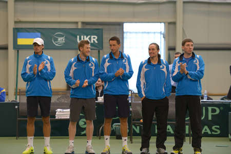 mikhail: Dnepropetrovsk, Ukraine - April 6, 2013: Ukrainian team before Davis Cup match in Dnepropetrovsk, Ukraine on April 6, 2013. Left to right: Denis Molchanov, Illya Marchenko, Sergey Stakhovsky, Alexander Dolgopolov, Mikhail Filima
