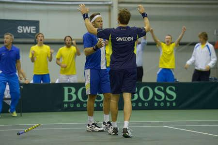 Dnepropetrovsk, Ukraine - April 6, 2013: Robert Lindstedt (left) and Johan Brunstrom, Sweden win the Davis Cup match between Ukraine and Sweden in Dnepropetrovsk, Ukraine on April 6, 2013