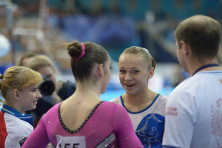 teammates: Moscow, Russia - April 20, 2013: Maria Paseka, Russia talks with her teammates after exercise on uneven bars in final of 5th European Championships in Artistic Gymnastics in Moscow, Russia on April 20, 2013
