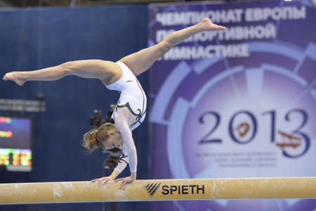 Moscow, Russia - April 21, 2013: Katarzyna Jurkowska, Poland performs exercise on balance beam in final of 5th European Championships in Artistic Gymnastics in Moscow, Russia on April 21, 2013