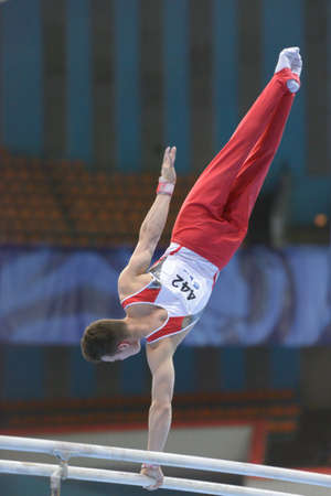pascal: Moscow, Russia - April 21, 2013  Pascal Bucher, Switzerland performs exercise on parallel bars in final of 5th European Championships in Artistic Gymnastics in Moscow, Russia on April 21, 2013 Editorial