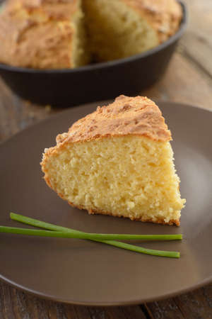 Just baked corn bread on a rustic table