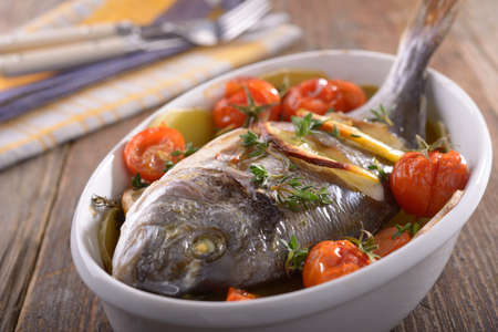 sea bream: Baked sea bream with vegetables in a baking dish Stock Photo