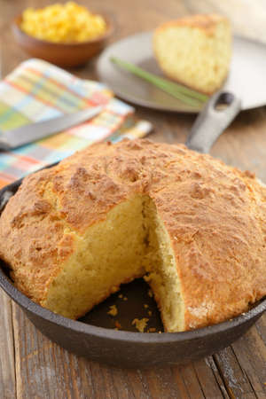 cornbread: Just baked corn bread on a rustic table