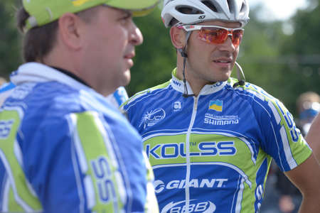 vitaly: Kiev, Ukraine - May 24, 2013  Vitaly Buts with teammates from Kolss cycling team, Ukraine, on the finish of Race Horizon Park in Kiev, Ukraine on May 24, 2013
