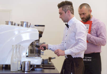 horozontal: Dnepropetrovsk, Ukraine - May 30, 2013: Barista Artem Molchan make coffee during 5th Ukrainian Latte Art Championship in Dnepropetrovsk, Ukraine on May 30, 2013 Editorial