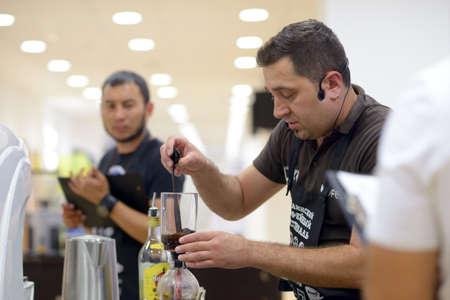 vitaly: Dnepropetrovsk, Ukraine - June 1, 2013  Barista Vitaly Panchenko makes the beverage during 5th Ukrainian Coffee In Good Spirits Championship in Dnepropetrovsk, Ukraine on June 1, 2013