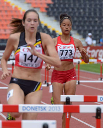 Donetsk, Ukraine - July 11, 2013: Samantha Gonzalez of USA (right) and Nenah De Coninck of Belgium compete in semi-final of 400 m hurdles during 8th IAAF World Youth Championships in Donetsk, Ukraine on July 11, 2013