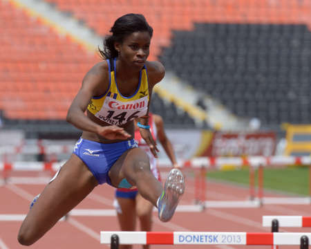 Donetsk, Ukraine - July 11, 2013: Tia-Adana Belle of  Barbados compete in semi-final of 400 m hurdles during 8th IAAF World Youth Championships in Donetsk, Ukraine on July 11, 2013