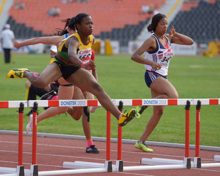Donetsk, Ukraine - July 11, 2013: Rushelle Burton of Jamaica (left) and Shirin Irving of Great Britain compete in semi-final of 100 m hurdles during 8th IAAF World Youth Championships in Donetsk, Ukraine on July 11, 2013