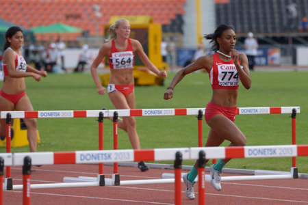 murillo: Donetsk, Ukraine - July 11, 2013: Dior Hall of USA (right), Mari Forbord Anderssen of Norway (center), and Steffi Murillo of Peru compete in semi-final of 100 m hurdles during 8th IAAF World Youth Championships in Donetsk, Ukraine on July 11, 2013