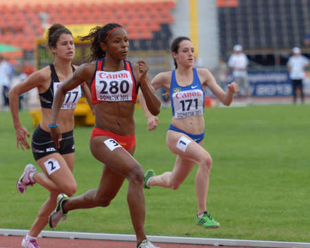 silva: Donetsk, Ukraine - July 11, 2013: Zoe Hobbs of New Zealand (left), Angela Tenorio of Ecuador (center), and Mirna da Silva of Brazil compete in 100 meters during 8th IAAF World Youth Championships in Donetsk, Ukraine on July 11, 2013