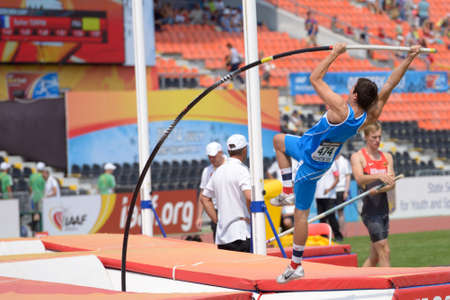 donetsk: Donetsk, Ukraine - July 12, 2013: Luigi Colella of Italy competes in Pole Vault during 8th IAAF World Youth Championships in Donetsk, Ukraine on July 12, 2013 Editorial