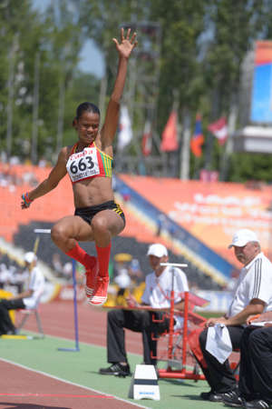 Donetsk, Ukraine - July 13, 2013: Kristal Liburd, Saint Kitts And Nevis, in long jump competitions during World Youth Championships in Donetsk, Ukraine on July 13, 2013