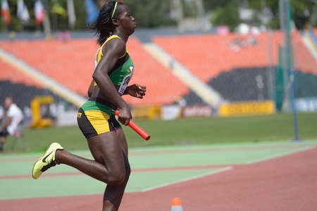 medley: Donetsk, Ukraine - July 13, 2013: Tiffany James of Jamaica competes in the medley relay competitions during World Youth Championships in Donetsk, Ukraine on July 13, 2013 Editorial