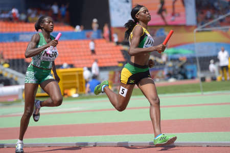 medley: Donetsk, Ukraine - July 13, 2013: Yanique McNeil of Jamaica (right) and Abimbola Junaid of Nigeria compete in the medley relay competitions during World Youth Championships in Donetsk, Ukraine on July 13, 2013