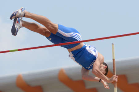 Donetsk, Ukraine - July 12, 2013: Petros Hatziou of Greece competes in Pole Vault during 8th IAAF World Youth Championships in Donetsk, Ukraine on July 12, 2013