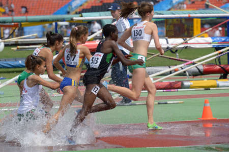 steeplechase: Donetsk, Ukraine - July 12, 2013: Girls compete in 2000 m steeplechase during 8th IAAF World Youth Championships in Donetsk, Ukraine on July 12, 2013
