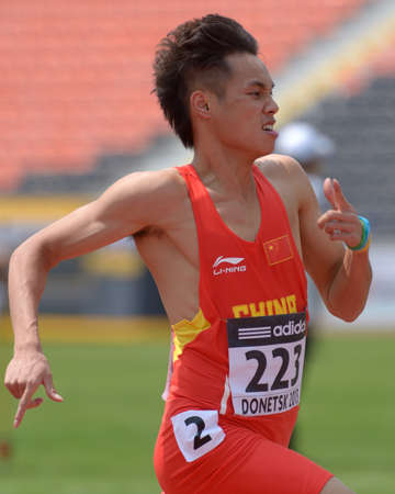 mococa: Donetsk, Ukraine - July 12, 2013: Youxue Mo of China win the heat in 200 metres during 8th IAAF World Youth Championships in Donetsk, Ukraine on July 12, 2013 Editorial