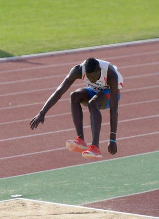 martinez: Donetsk, Ukraine - July 12, 2013: Lazaro Martinez of Cuba competes in the triple jump during 8th IAAF World Youth Championships in Donetsk, Ukraine on July 12, 2013
