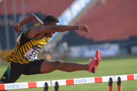 donetsk: Donetsk, Ukraine - July 12, 2013: Jaheel Hyde of Jamaica competes in semi-final of 110 m hurdles during 8th IAAF World Youth Championships in Donetsk, Ukraine on July 12, 2013