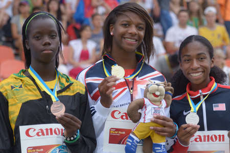 Donetsk, Ukraine - July 13, 2013: Medalists in 400 metres during 8th IAAF World Youth Championships in Donetsk, Ukraine on July 13, 2013. Left to right: Tiffany James of Jamaica, Sabrina Bakare of Great Britain, Olivia Baker of USA Stock Photo - 20975901