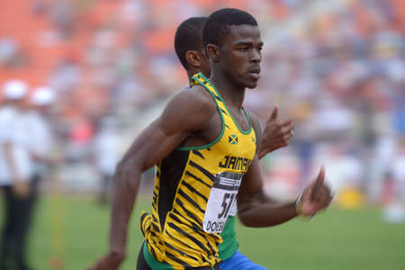 metres: Donetsk, Ukraine - July 13, 2013: Michael OHara of Jamaica win the heat in semi-final on 200 metres during 8th IAAF World Youth Championships in Donetsk, Ukraine on July 13, 2013