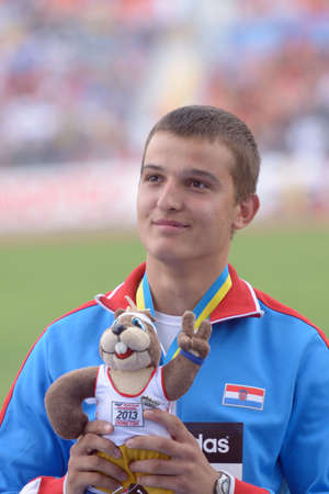 hammer throw: Donetsk, Ukraine - July 13, 2013: Matija Greguric of Croatia win gold medal in hammer throw during 8th IAAF World Youth Championships in Donetsk, Ukraine on July 13, 2013 Editorial