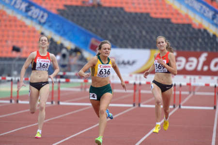 Donetsk, Ukraine - July 13, 2013: Helene Swanepoel of South Africa (center), Eileen Demes (left) and Lisa-Marie Jacoby, both of Germany compete in the final of 400 metres hurdles during 8th IAAF World Youth Championships in Donetsk, Ukraine on July 13, 20