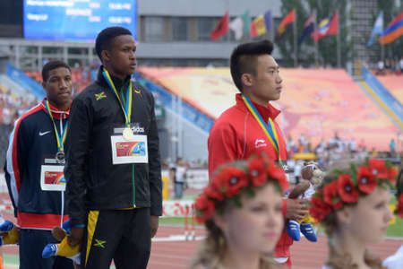 Donetsk, Ukraine - July 13, 2013: Medalists in 110 metres hurdles on the medal ceremony during 8th IAAF World Youth Championships in Donetsk, Ukraine on July 13, 2013. Left to right: Marlon Humphrey of USA, Jaheel Hyde of Jamaica, Yang Lu of China Stock Photo - 20975924