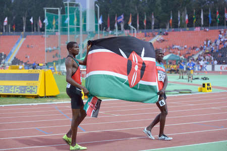 Donetsk, Ukraine - July 13, 2013: Alfred Kipketer (right) and Patrick Kiprotich Ronoh of Kenya with national flag after the final in 800 meters during 8th IAAF World Youth Championships in Donetsk, Ukraine on July 13, 2013