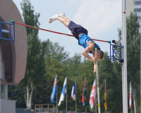 Donetsk, Ukraine - July 14, 2013: Tomas Wecksten of Finland competes in the final in pole vault during 8th IAAF World Youth Championships in Donetsk, Ukraine on July 14, 2013