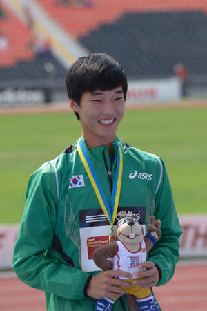to woo: Donetsk, Ukraine - July 14, 2013: Sanghyeok Woo of Korea with his gold medal in high jump during 8th IAAF World Youth Championships in Donetsk, Ukraine on July 14, 2013 Editorial
