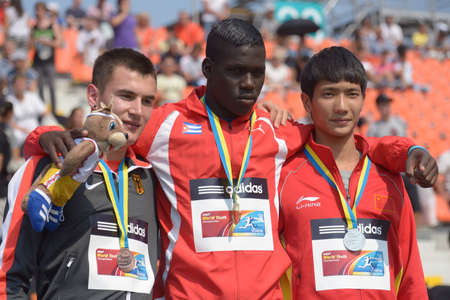Donetsk, Ukraine - July 14, 2013: Medalists in triple jump on medal ceremony during 8th IAAF World Youth Championships in Donetsk, Ukraine on July 14, 2013. Left to right: Dimitri Antonov of Germany, Lazaro Martinez of Cuba, Yaoqing Fang of China