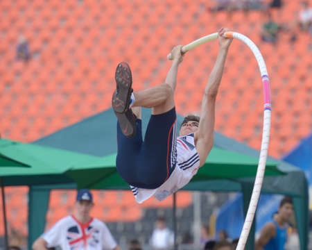 Donetsk, Ukraine - July 14, 2013: Harry Coppell of Great Britain fight for his gold medal in the final in pole vault during 8th IAAF World Youth Championships in Donetsk, Ukraine on July 14, 2013