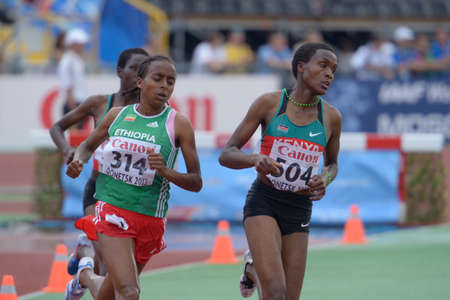 steeplechase: Donetsk, Ukraine - July 14, 2013: Rosefline Chepngetich (left), Daisy Jepkemei (right), both of Kenya, and Weynshet Ansa of Ethiopia fight for medals in the final of 2000 metres steeplechase during 8th IAAF World Youth Championships in Donetsk, Ukraine on