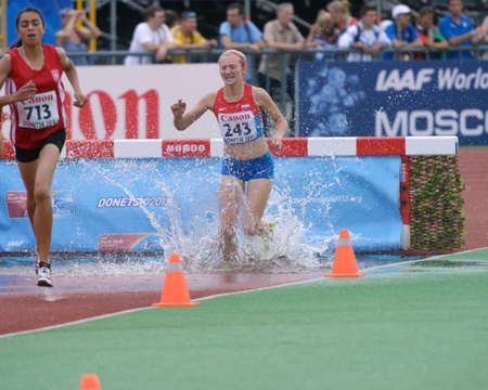 steeplechase: Donetsk, Ukraine - July 14, 2013: Marwa Bouzayani of Tunisia (left) and Kristina Bozic of Croatia compete in the final of 2000 metres steeplechase during 8th IAAF World Youth Championships in Donetsk, Ukraine on July 14, 2013 Editorial
