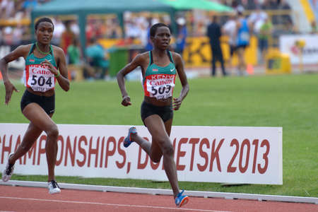 steeplechase: Donetsk, Ukraine - July 14, 2013: Rosefline Chepngetich (right) and Daisy Jepkemei, both of Kenya, fight for medals in the final of 2000 metres steeplechase during 8th IAAF World Youth Championships in Donetsk, Ukraine on July 14, 2013 Editorial