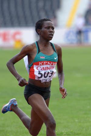 steeplechase: Donetsk, Ukraine - July 14, 2013: Rosefline Chepngetich of Kenya fight for her gold medal in the final of 2000 metres steeplechase during 8th IAAF World Youth Championships in Donetsk, Ukraine on July 14, 2013