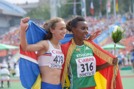 Donetsk, Ukraine - July 14, 2013: Anita Hinriksdottir of Iceland (left) and Dureti Edao of Ethiopia win medals in the final on 800 meters during 8th IAAF World Youth Championships in Donetsk, Ukraine on July 14, 2013