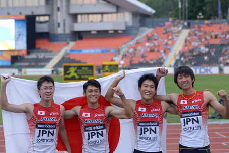yui: Donetsk, Ukraine - July 14, 2013: Team Japan win bronze in the medley relay during 8th IAAF World Youth Championships in Donetsk, Ukraine on July 14, 2013. Left to right: Kaisei Yui, Kakeru Yamaki, Shunto Nagata, Daiki Oda Editorial