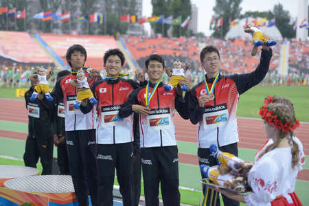 yui: Donetsk, Ukraine - July 14, 2013: Team Japan win bronze in the medley relay during 8th IAAF World Youth Championships in Donetsk, Ukraine on July 14, 2013. Right to left: Kaisei Yui, Kakeru Yamaki, Shunto Nagata, Daiki Oda Editorial