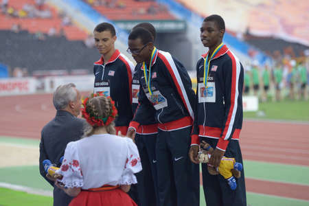 medley: Donetsk, Ukraine - July 14, 2013: Team USA win silver in the medley relay during 8th IAAF World Youth Championships in Donetsk, Ukraine on July 14, 2013. Left to right: Taylor McLaughlin, Jaalen Jones, Ryan Clark, Noah Lyles Editorial
