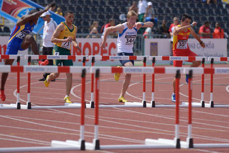 Donetsk, Ukraine - July 11, 2013: Boys compete in 110 metres hurdles during 8th World Youth Championships in Donetsk, Ukraine on July 11, 2013. Left to right: Oscar Palacios of Colombia, Pieter-John Waterboer of South Africa, Thomas Delmeule of France, Ge